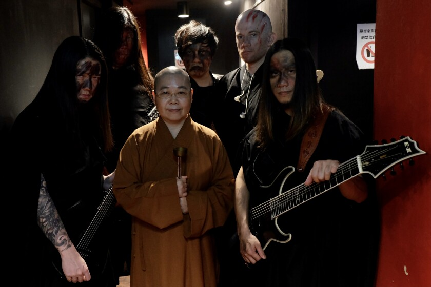 Buddhist nun Miao Ben and Dharma band members