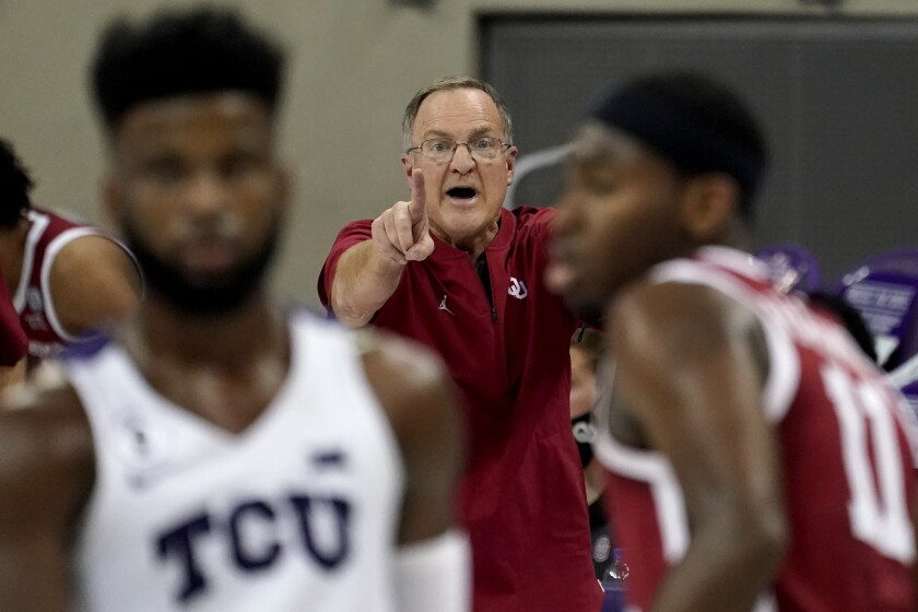 Oklahoma head coach Lon Kruger, center, instructs his team in the second half of an NCAA college basketball game against TCU in Fort Worth, Texas, Sunday, Dec. 6, 2020. (AP Photo/Tony Gutierrez)