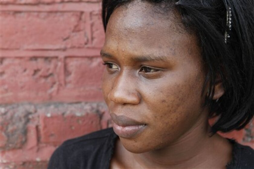 In this photo taken Jan. 14, 2011, Mikeisha Simpson poses for a portrait in Kingston, Jamaica. Simpson, 23, hopes to transform her dark complexion to a cafe-au-lait-color common among Jamaica's elite and favored by many men in her neighborhood. She believes a fairer skin could be her ticket to a better life, so she spends her savings on black-market concoctions that promise to lighten her pigment. (AP Photo/Caterina Werner)