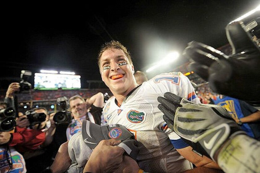 Tim Tebow celebrates after leading Florida to a 24-14 win over Oklahoma for the BCS national championship on Jan. 8, 2009.
