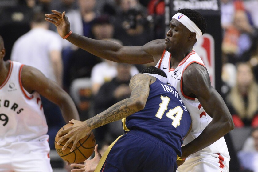 Pelicans forward Brandon Ingram tries to drive past Raptors forward Pascal Siakam during the first half Tuesday in Toronto.