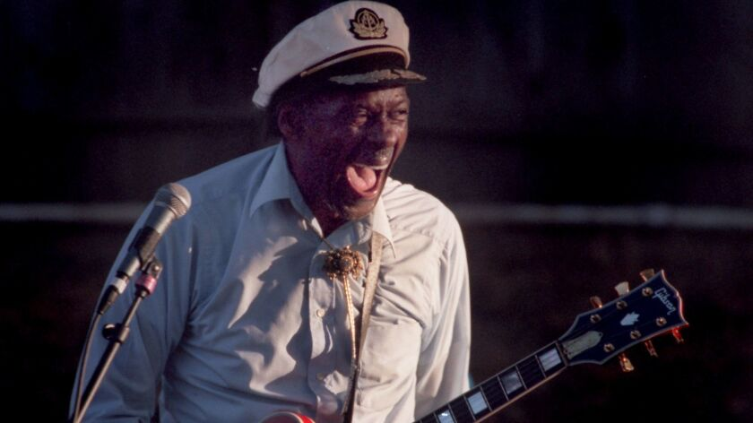 Chuck Berry, shown performing in Orange County in 1997, could be aloof or sweetly endearing up close and personal, writes longtime Times pop music writer Randy Lewis.
