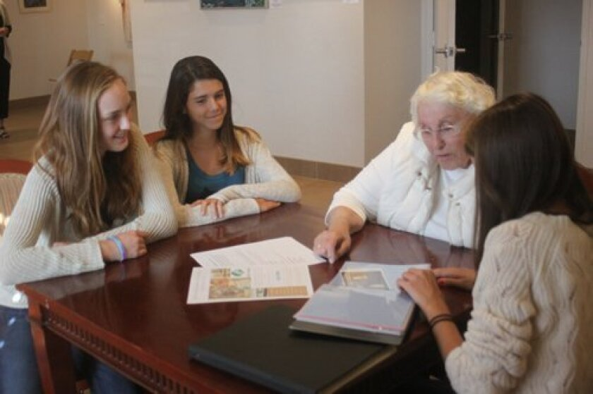 Nora Joyce and Lizzie Craig chat with Mary Jane Fee about her grandchildren and living in La Jolla, while Dara Pite shows an example of a scrapbook they could make if Fee signs up for Silver Stories. Ashley Mackin