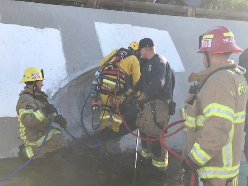 Firefighters help free a 28-year-old man who was wedged 270 feet into an 18-inch-wide storm drain pipe in Temecula.