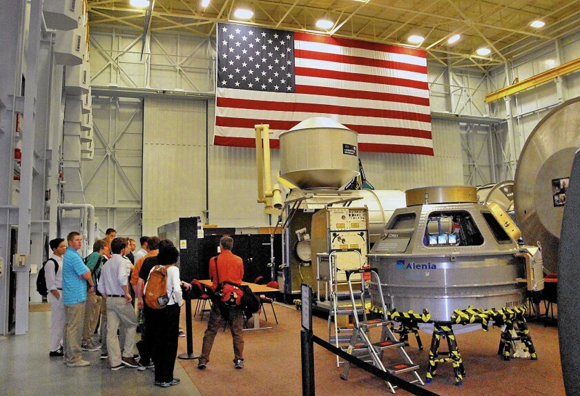 A Level 9 tour group learns about astronaut training done in mockups of the International Space Station at the Johnson Space Center in Houston.