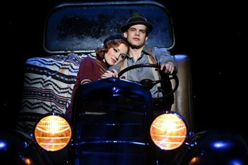 """In this theater image released by Jeffrey Richards Associates, Laura Osnes, left, and Jeremy Jordan are shown in the musical """"Bonnie and Clyde,"""" in New York.  Producers announced that the show will play its final performance on Friday, Dec. 30. (AP Photo/Jeffrey Richards Associates, Nathan Johnson)"""