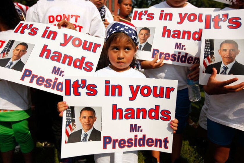 """According to the Applied Research Center's report """"Shattered Families,"""" at least 5,000 children of immigrants live in U.S. foster care because their parents were detained or deported. Above: Demonstrators describing themselves as """"Obama Orphans,"""" or children whose parents have been deported, are seen outside the White House in 2010."""