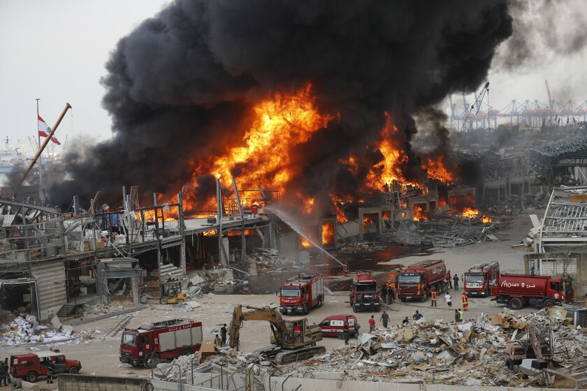 Fire burns in the port in Beirut on Thursday, near the site of last month's devastating explosion.