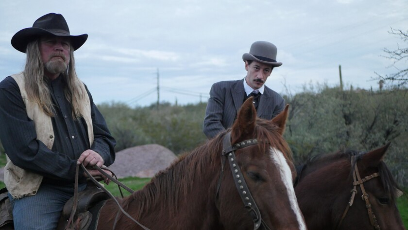 "Charlie Motley, and Own Conway on horseback in the movie ""Eminence Hill."""