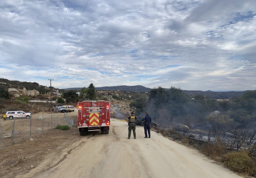 Authorities responding to a report of a fire Thursday near Potrero found a body in a vehicle near where the blaze started.