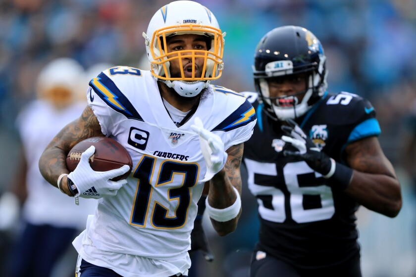 Chargers' Keenan Allen (13) rushes for yardage during the game against the Jacksonville Jaguars on Dec. 8 Jacksonville, Fla.