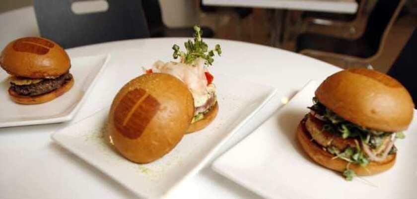 Customers can enjoy different burgers such as the Le Cordon Bleu Burger and the Ahi Tuna Burger at Umami Burger in Pasadena.