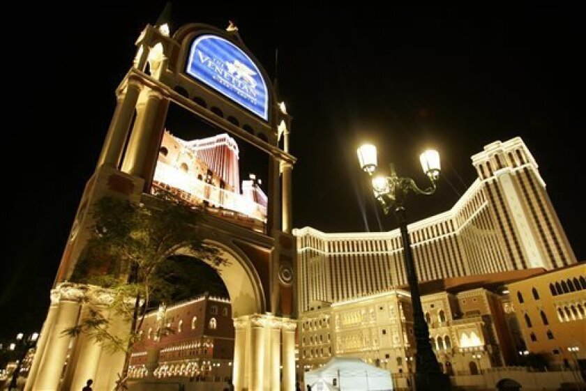 FILE - This Aug. 28, 2007 file photo shows the Venetian Macao Resort Hotel in Macau. Las Vegas Sands Corp., the U.S. gambling company controlled by billionaire Sheldon Adelson, which owned the Venetian resort, is being sued for $328 million over the way it won a lucrative gaming license in the Asian casino hub. Nine years of litigation between a Hong Kong businessman and casino mogul Adelson is drawing to a close. Attorneys began closing arguments Thursday in the dispute between Las Vegas Sands