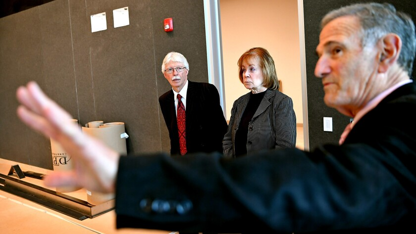 BioMed CEO David Meyer, right, gives a tour to Melanie and Richard Lundquist inside a new biomedical