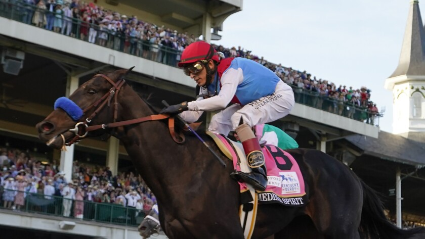 John Velazquez rides Medina Spirit to victory in the 147th running of the Kentucky Derby at Churchill Downs.