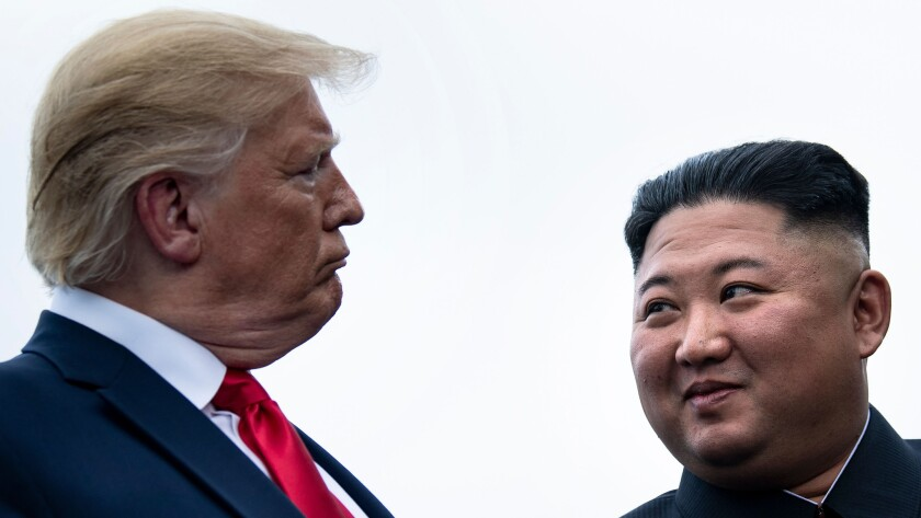 President Trump and North Korean leader Kim Jong Un talk in June 2019 before a meeting in the demilitarized zone.