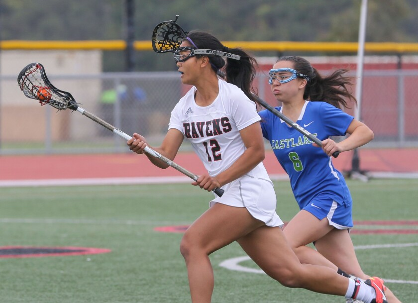 Anna Hong, of Canyon Crest, heads to the goal past Eastlake's Kera Hernandez.