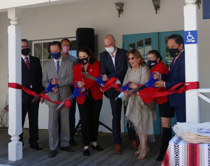 People cutting the ribbon at opening of Televisa Californias studio in Seaport Village