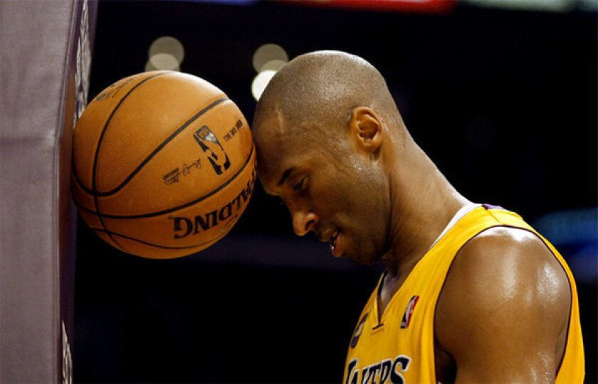 Lakers guard Kobe Bryant vents frustration during a game against the Toronto Raptors.