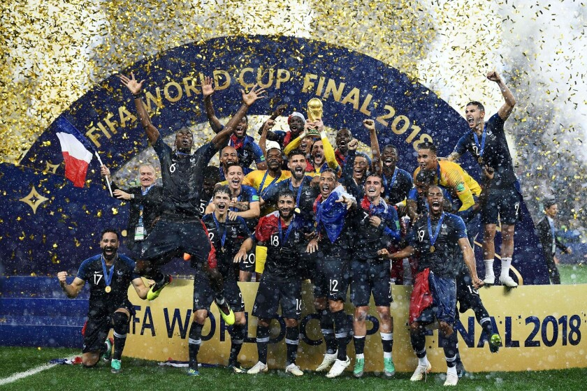 France's players celebrate as they hold their World Cup trophy during the trophy ceremony at the end of the Russia 2018 World Cup final football match between France and Croatia at the Luzhniki Stadium in Moscow.