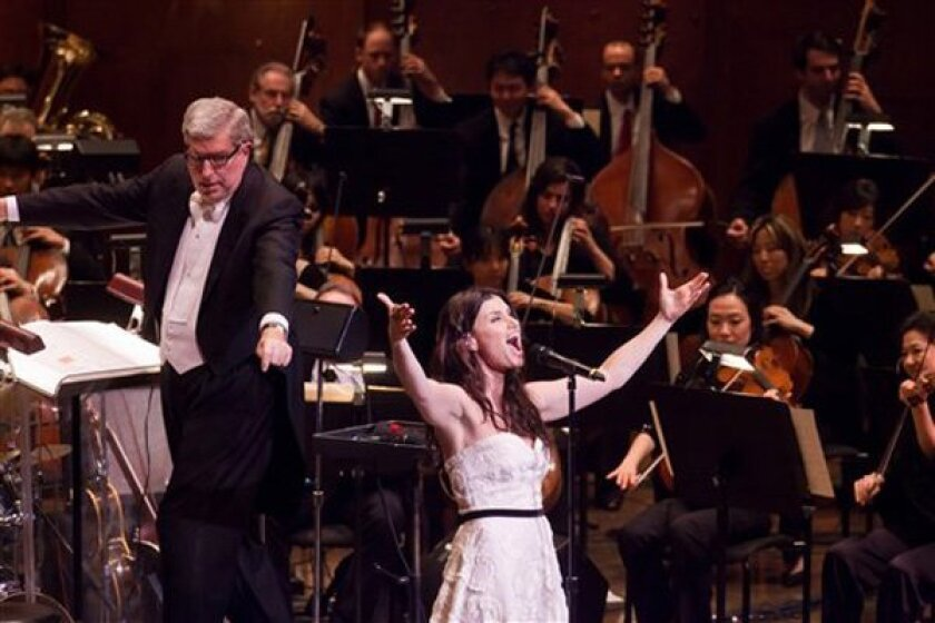 The Tony Award-winning Idina Menzel performs with the New York Philharmonic and conductor Marvin Hamlisch in a concert earlier this year. Menzel comes to the Salk Institute this weekend for a benefit show with the San Diego Symphony.