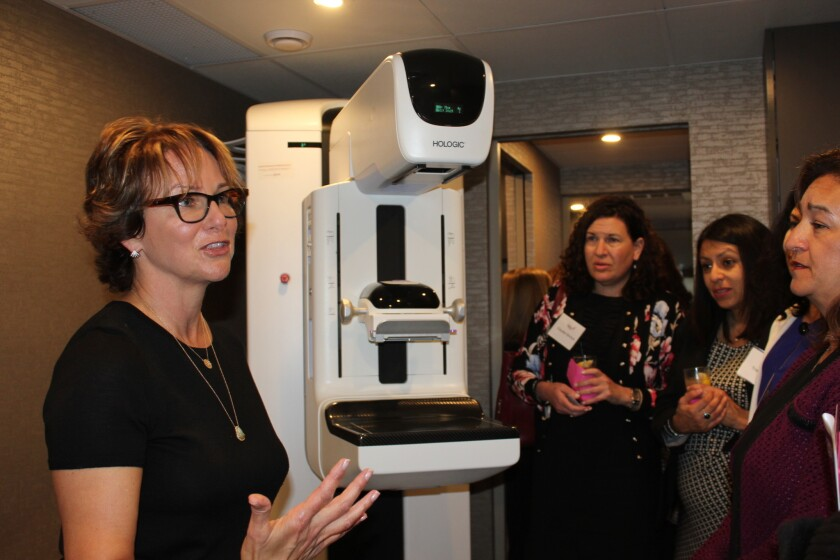Marsha Friend-Berkson gave tours at the event of the mobile mammography coach.