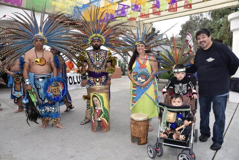 Danza Mexi´cayotl performers, with President/Board Chair Manny Aguilar of event co-sponsor La Colonia de Eden Gardens