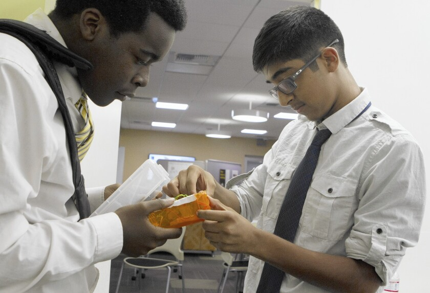 Urban TxT students Jacques Tolefree, 18, left, and Cesar Alvarenga, 15, make sure their device works before rehearsing their pitch for South L.A. Demo Day.