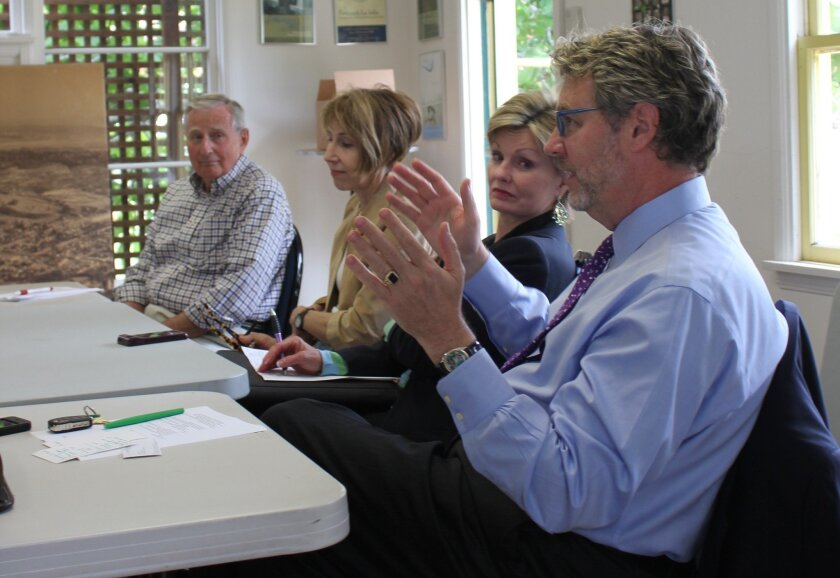 Christopher Beach (right), president and artistic director of the La Jolla Music Society listened as Save the La Jolla Post Office Task Force members discussed their current strategies for saving the Wall Street post office from relocation and sale. Pat Sherman photos
