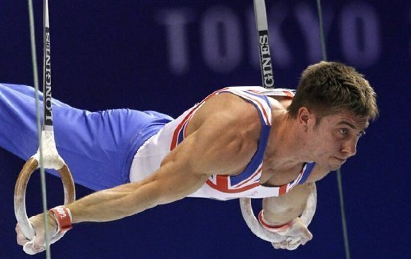 Britain's Ruslan Panteleymonov performs on the rings during the men's qualifying of the Artistic Gymnastics World Championships in Tokyo, Japan, Monday, Oct. 10, 2011. (AP Photo/Bullit Marquez)
