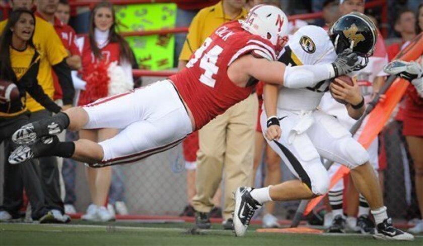 Nebraska's Jared Crick (94) takes down Missouri's Blaine Gabbert (11) earlier this season.