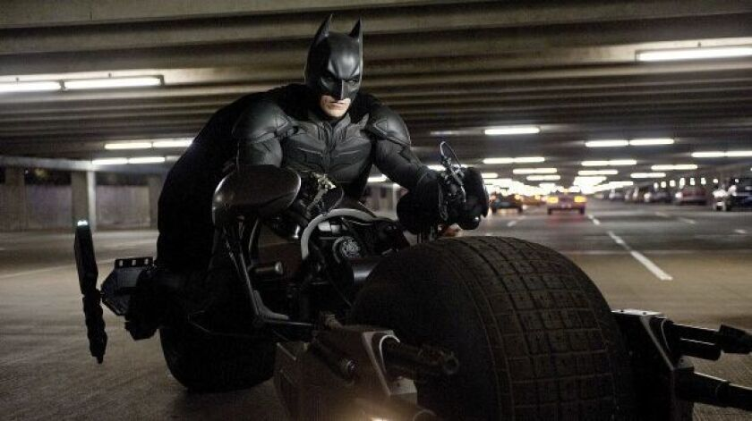 "Christian Bale is Batman in a scene from the action thriller ""The Dark Knight Rises."""