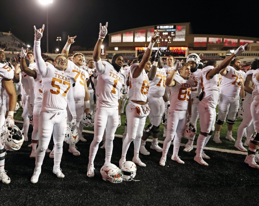 "FILE - In this Nov. 10, 2018, file photo, Texas players sing ""The Eyes of Texas"" after an NCAA college football game against Texas Tech in Lubbock, Texas. A group of University of Texas football players and athletes across several sports on Friday, June 12, 2020, urged the school to rename several campus buildings, change the traditional school song and donate a percentage of athletic department revenue to organizations supporting the Black Lives Matter movement. (AP Photo/Brad Tollefson, File)"