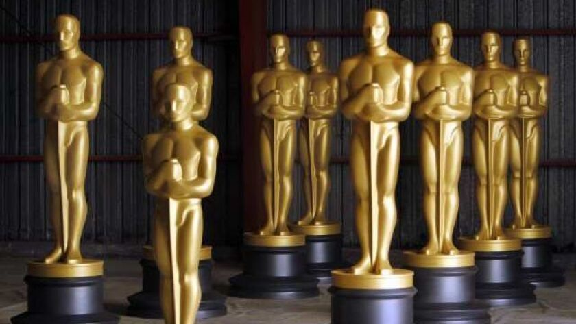 LOS ANGELES, CA - OCTOBER 19, 2009: Newly painted Oscar Statues dry after getting a fresh coat Mon