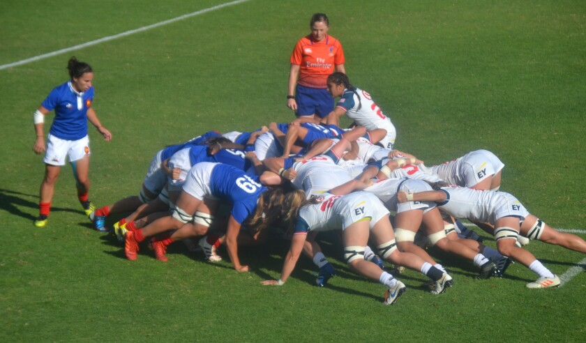 The U.S. women's rugby team engages in a scrum against France in the Super Series at USD.
