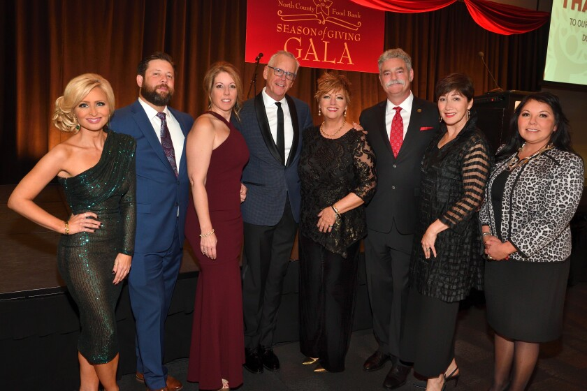 Lisa Remillard (event emcee), Brad Waters and Molly Addington Waters (she's an event co-chair), Pat Burke, Katherine Zimmer (event co-chair), James and Cheryl Floros (he's Jacobs and Cushman Food Bank president/CEO), Tishmall Turner (vice chair of Rincon Band; gala title sponsor)
