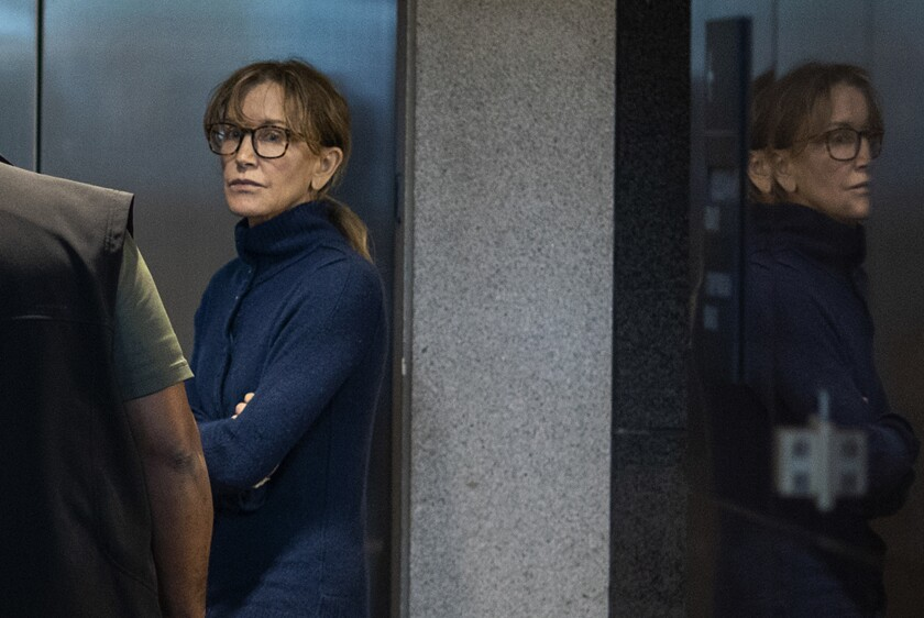 """Actress Felicity Huffman is seen inside the Edward R. Roybal Federal Building and U.S. Courthouse in Los Angeles. Huffman, 56, and Lori Loughlin, 54, who starred in """"Full House,"""" are charged with conspiracy to commit mail fraud and honest services mail fraud."""