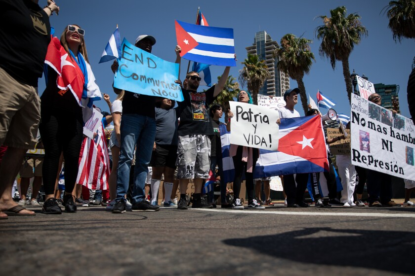 Protesters march through Downtown San Diego on Sunday to show support for Cubans unhappy with their government.