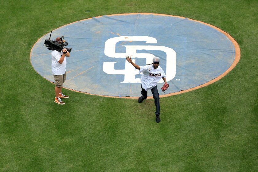 Snoop Dogg throws the ceremonial first pitch at the Padres game against the Braves.
