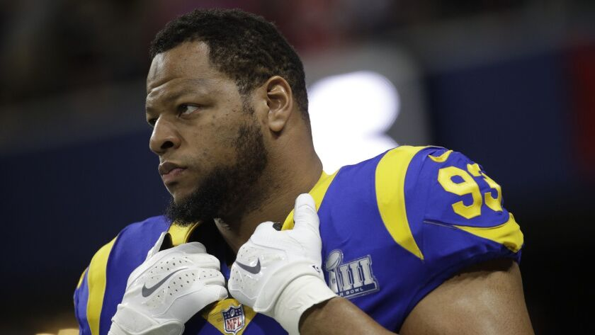Los Angeles Rams' Ndamukong Suh (93) warms up before the NFL Super Bowl 53 football game between the