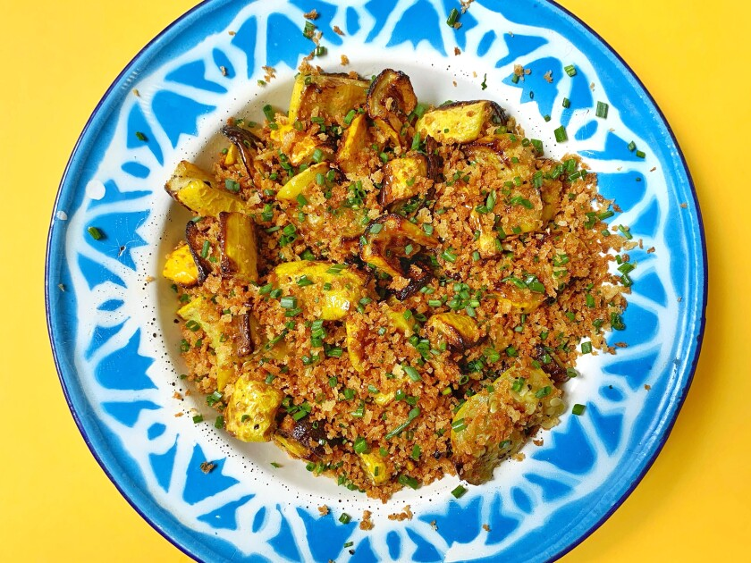 Deeply caramelized air-fried summer squash is topped with crunchy bread crumbs brightened with lemon zest and chives.
