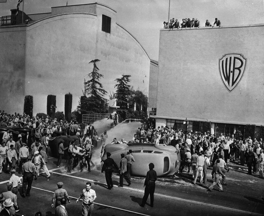 Oct. 5, 1945: Strikers and non-strikers clash outside the employee entrance to Warner Bros. Studios in Burbank.