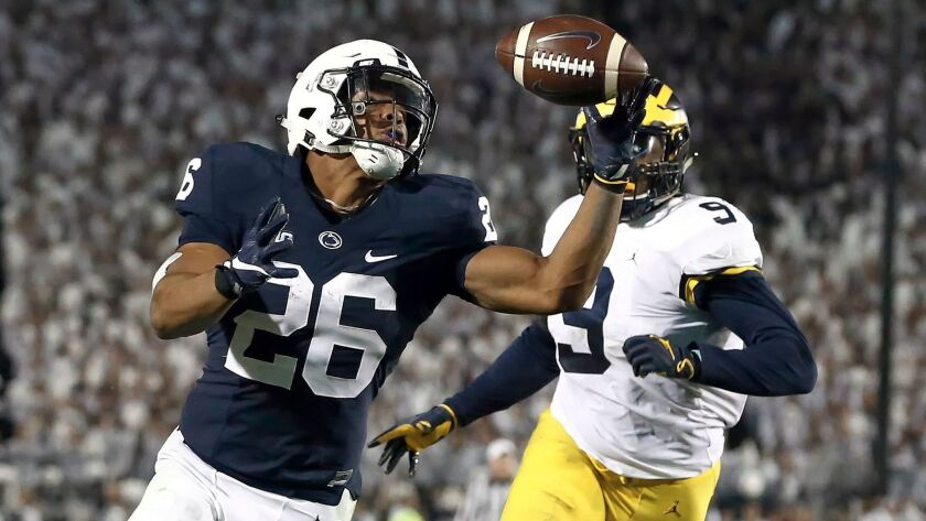 FILE - In this Saturday, Oct. 21, 2017, file photo, Penn State's Saquon Barkley (26) gains control o