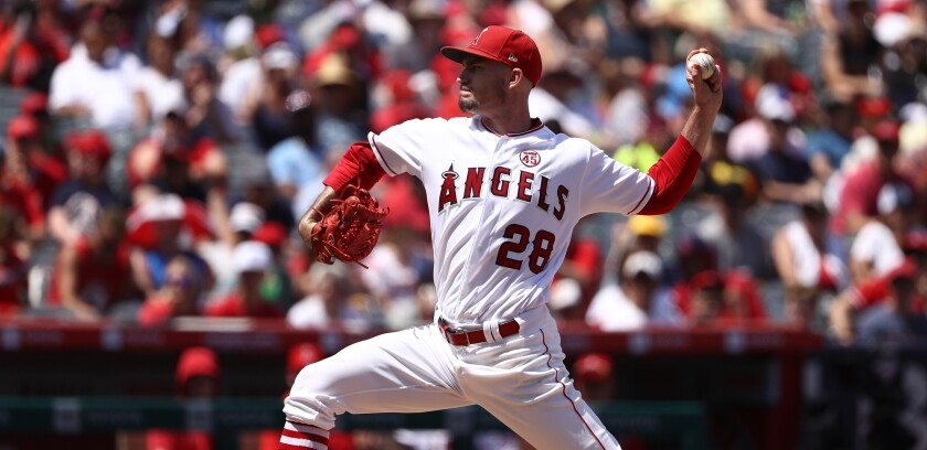 Angels starter Andrew Heaney delivers during the first inning against the Boston Red Sox on Sunday.