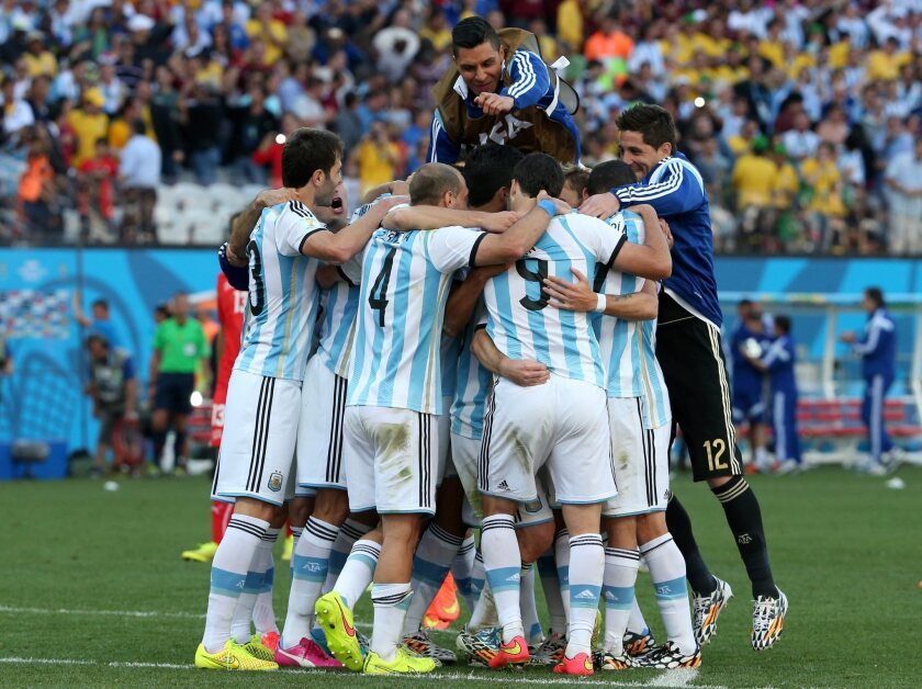 Argentine players celebrate after the FIFA World Cup 2014 round of 16 match between Argentina and Switzerland at the Arena Corinthians in Sao Paulo, Brazil, on Tuesday. Argentina beat Switzerland 1-0.