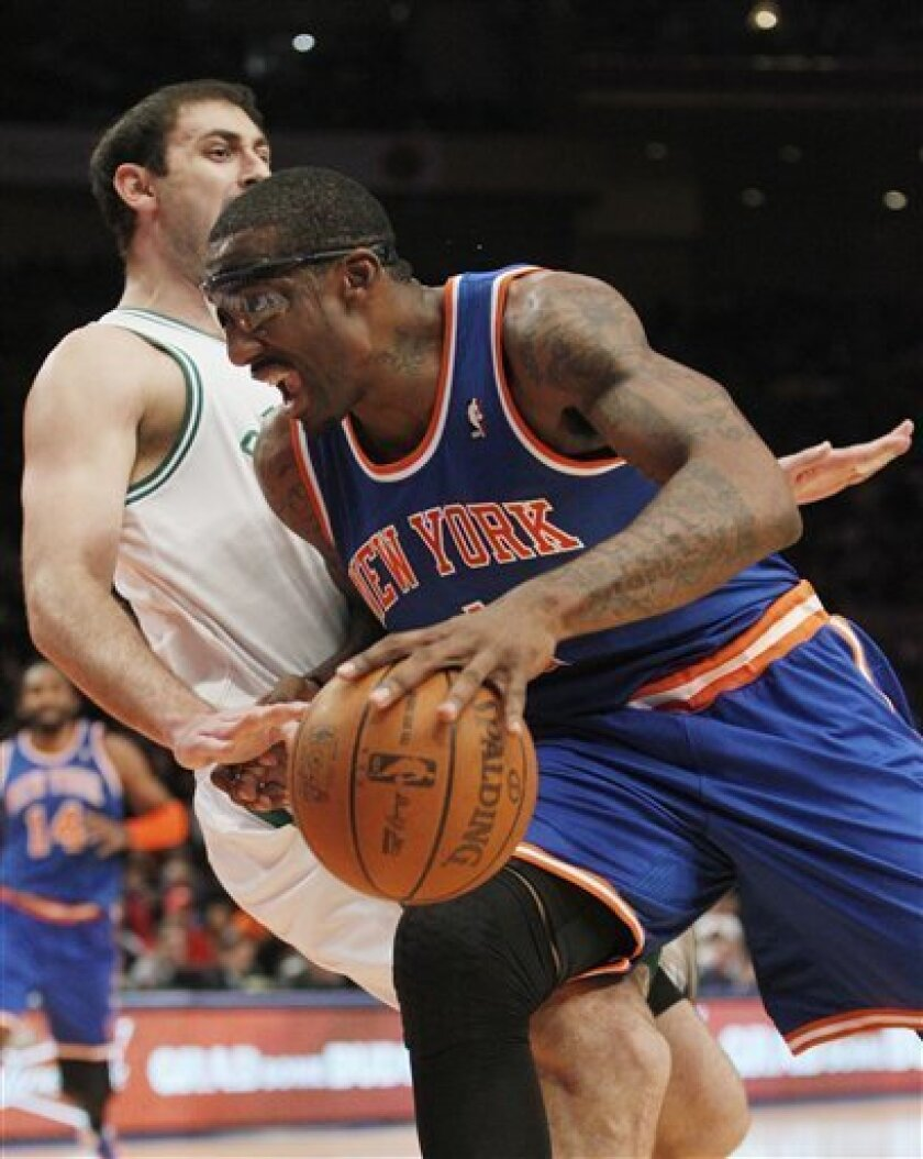 New York Knicks' Amare Stoudemire (1) drives past Boston Celtics' Nenad Krstic, of Serbia, during the first half of an NBA basketball game Monday, March 21, 2011, in New York. (AP Photo/Frank Franklin II)