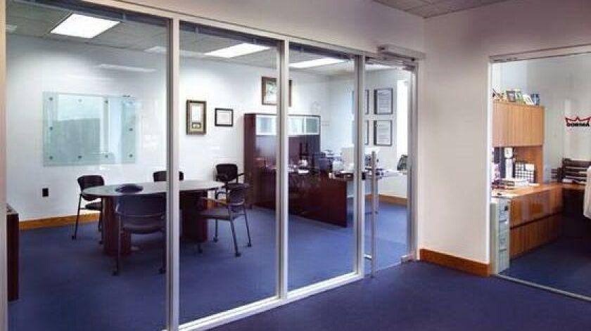 Brad McLaughlin has 11 employees at his BudTrader.com office in Encinitas.
