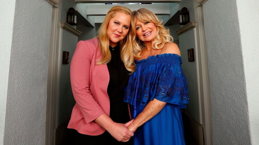 """Amy Schumer, left, and Goldie Hawn star as mother and daughter in their new movie, """"Snatched."""""""
