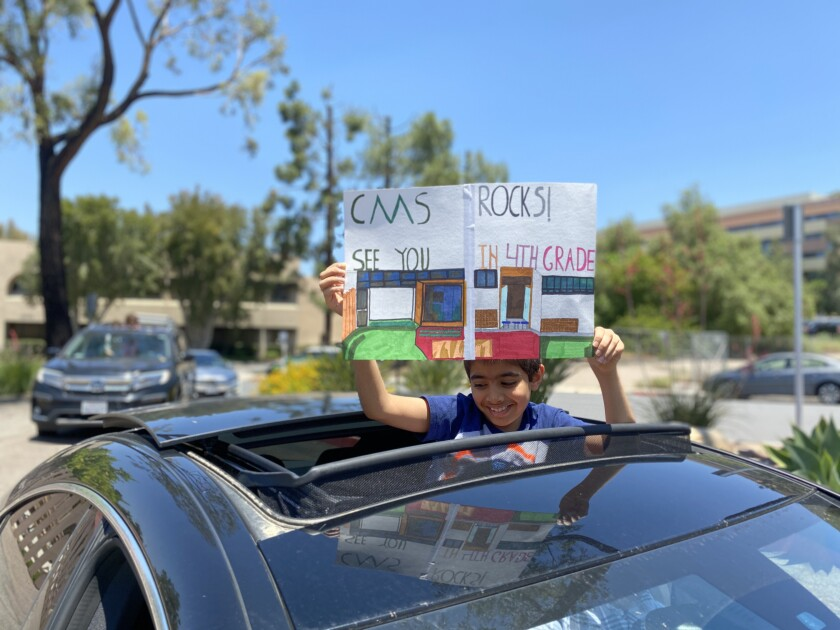 Ansh Ray, 9, of Country Montessori School, celebrates his move from third grade into fourth on the last day of school.