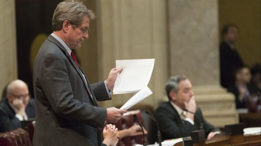 Wisconsin Sen. Tim Carpenter, a Democrat, questions a list of appointment referrals submitted to the Senate at the Capitol in Madison on Tuesday.